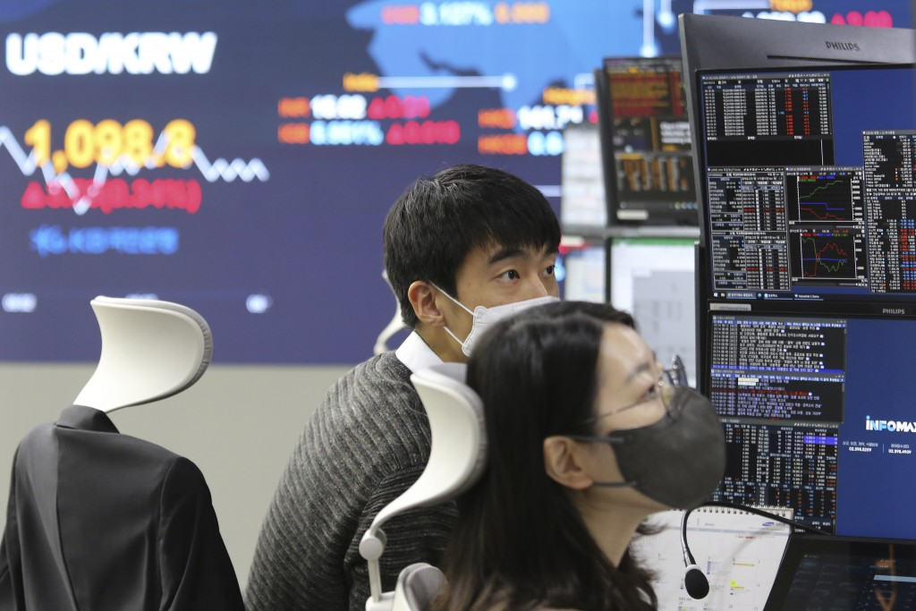 Currency traders watch monitors at the foreign exchange dealing room of a KB Kookmin Bank branch in Seoul, South Korea, Thursday, Jan. 14, 2021. Share...
