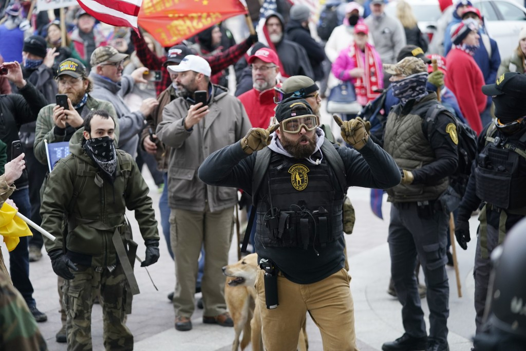 FILE - In this Jan. 6, 2021, file photo, Trump supporters gather outside the Capitol in Washington. As rioters converged on the U.S. Capitol building,...