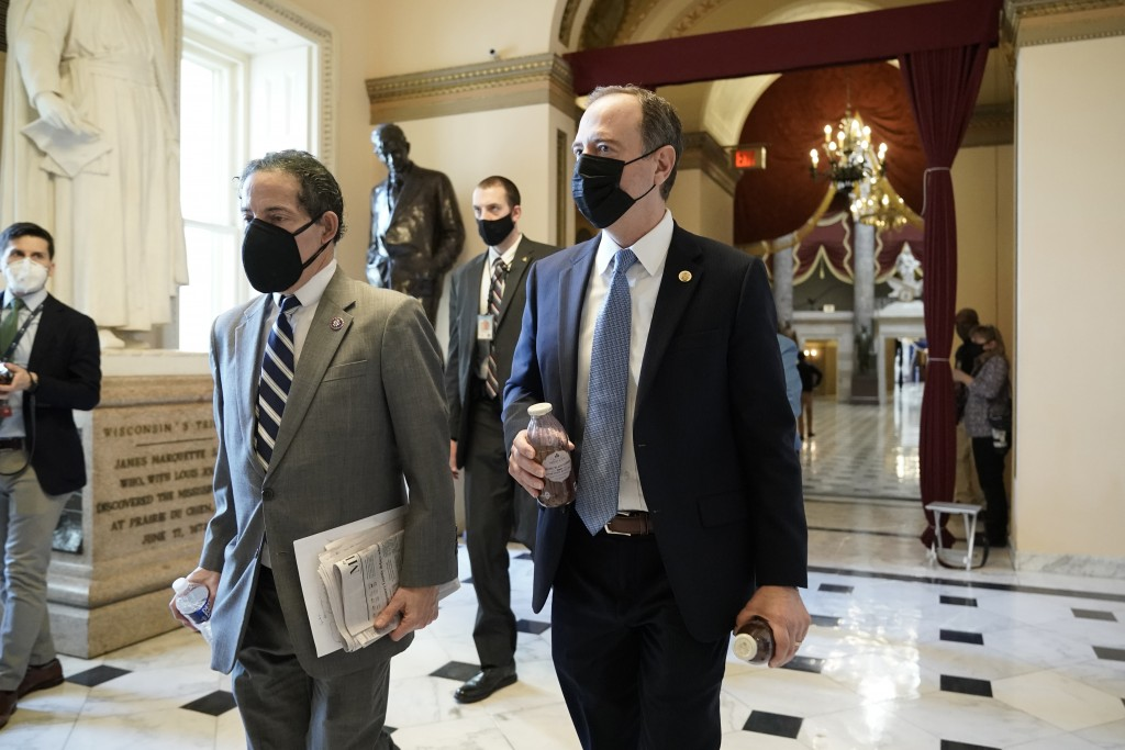 Rep. Jamie Raskin, D-Md., left, walks with Rep. Adam Schiff, D-Calif., at the Capitol in Washington, Wednesday, Jan. 13, 2021, as the House of Represe...