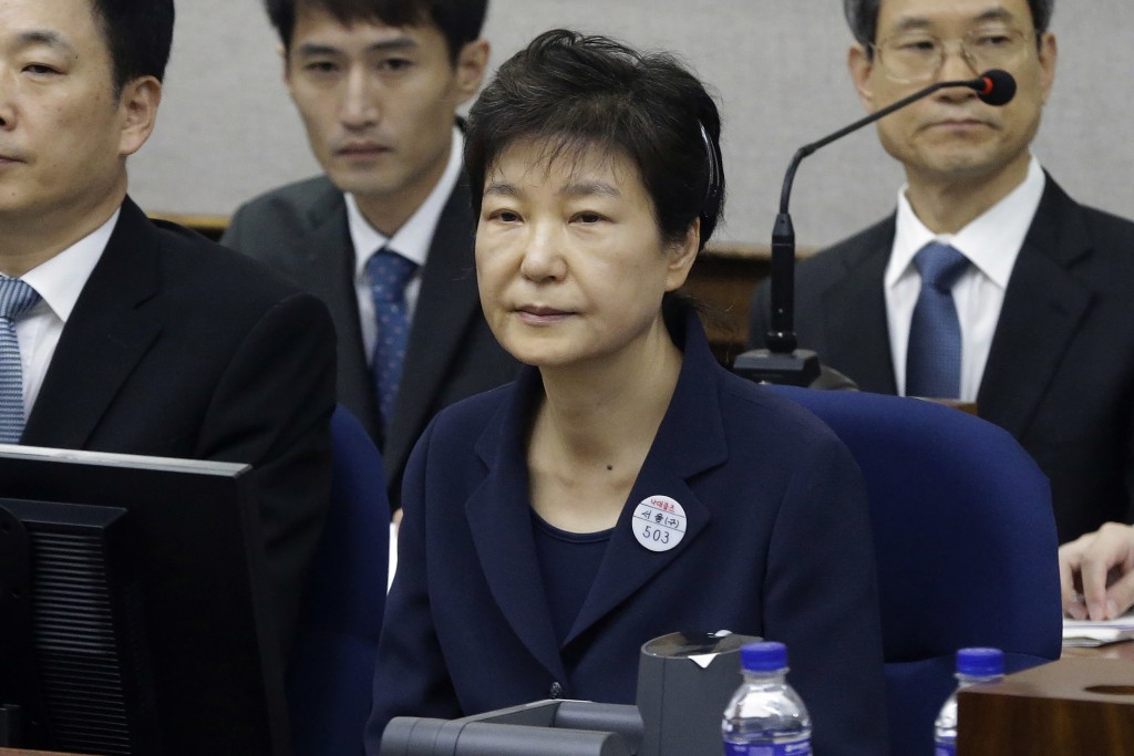 FILE - In this May 23, 2017, file photo, former South Korean President Park Geun-hye, front, sits for her trial at the Seoul Central District Court in...