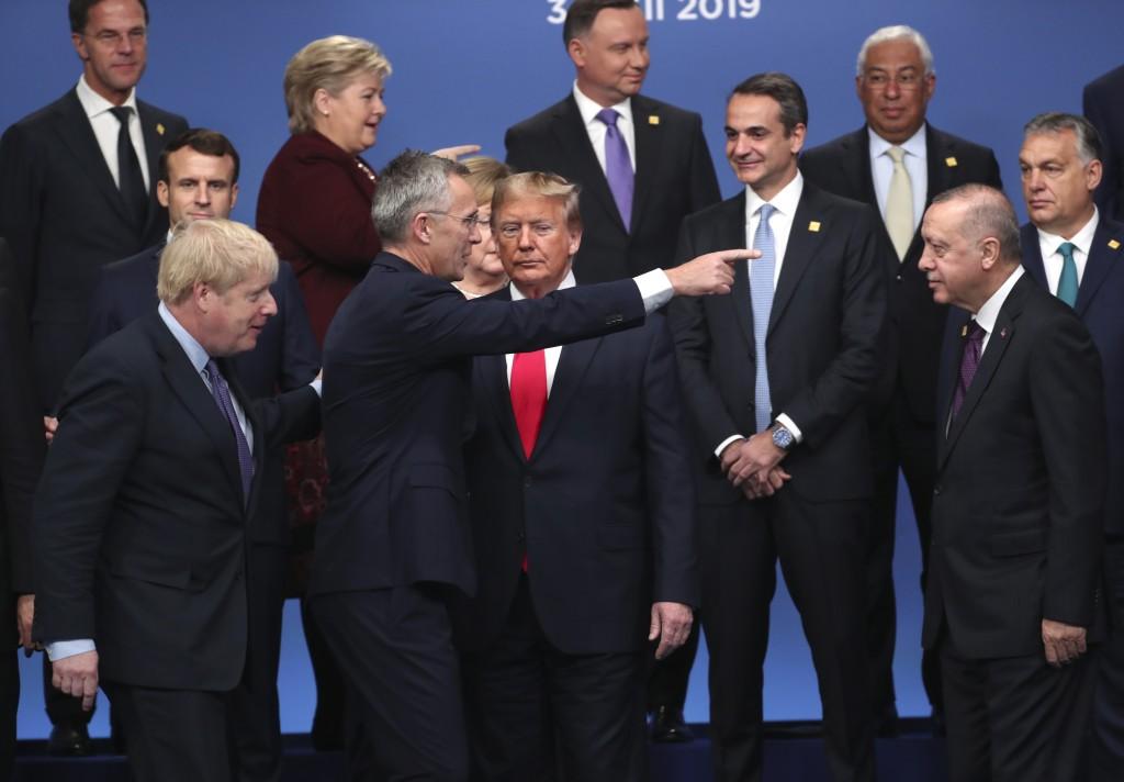 FILE - In this Wednesday, Dec. 4, 2019 file photo Britain's Prime Minister Boris Johnson, left, looks on as NATO Secretary General Jens Stoltenberg, c...