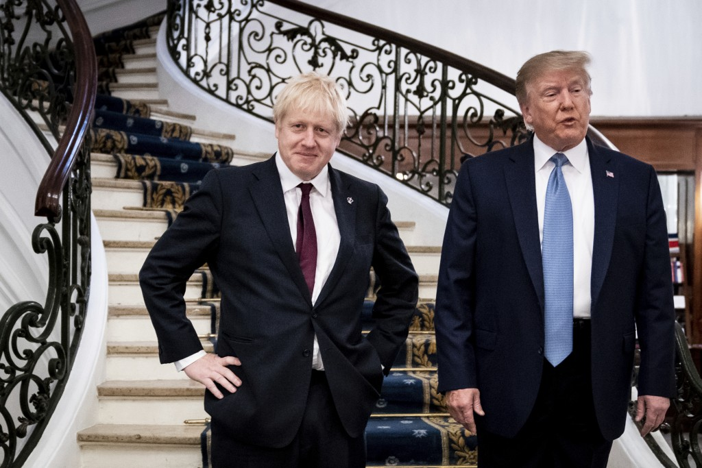 FILE - In this Sunday, Aug. 25, 2019 file photo President Donald Trump and Britain's Prime Minister Boris Johnson, left, speak to the media before a w...
