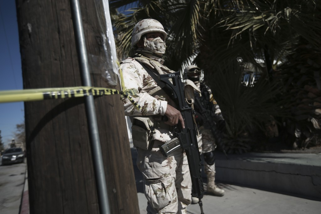 Soldiers stand guard outside General Hospital, one of the locations where medical workers were being given the Pfizer COVID-19, on the first day of co...
