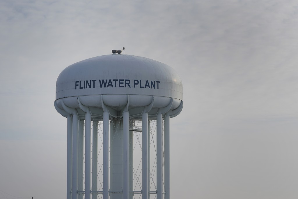 The Flint Water Plant tower is shown in Flint, Mich., Wednesday, Jan. 13, 2021.  Some Flint residents impacted by months of lead-tainted water are loo...