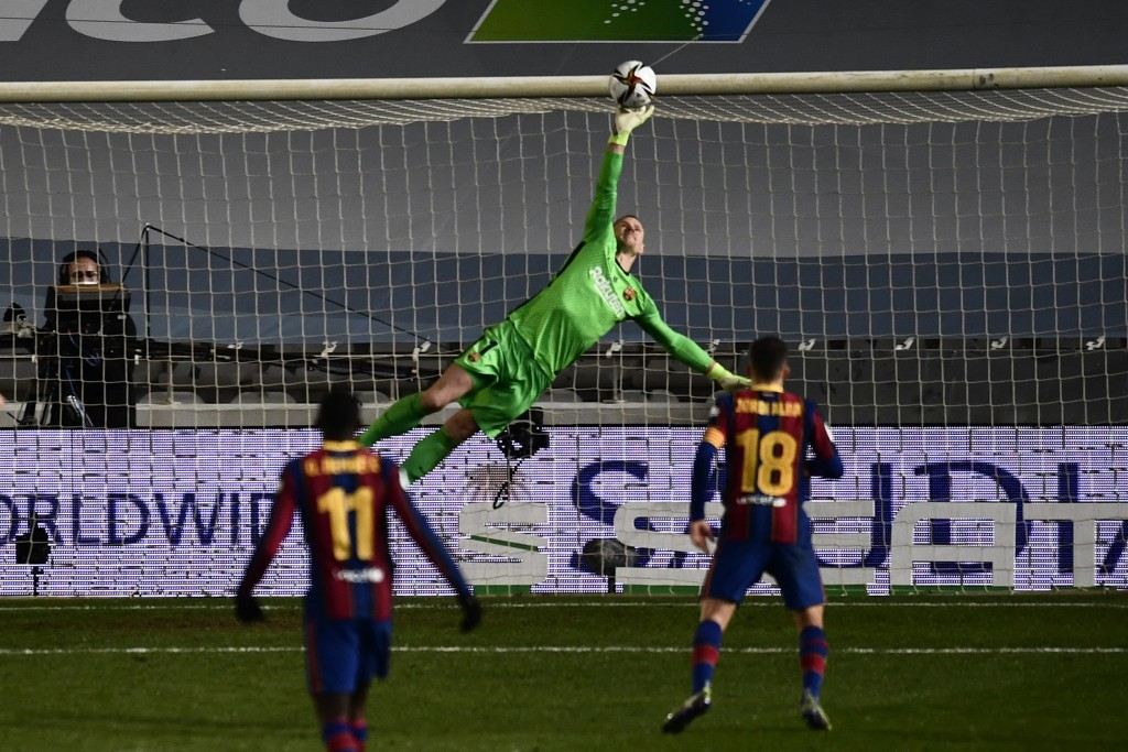 Barcelona's goalkeeper Marc-Andre ter Stegen makes a save during Spanish Super Cup semi final soccer match between Barcelona and Real Sociedad at Nuev...