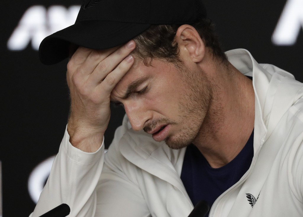 FILE - In this Tuesday, Jan. 15, 2019 file photo Britain's Andy Murray reacts during a press conference following his first round loss to Spain's Robe...