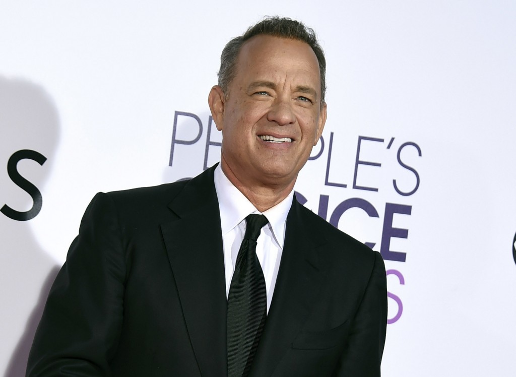FILE - In this Wednesday, Jan. 18, 2017, file photo, Tom Hanks arrives at the People's Choice Awards at the Microsoft Theater in Los Angeles. Hanks wi...