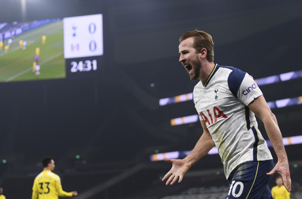 Tottenham's Harry Kane celebrates after scoring his side's opening goal during the English Premier League soccer match between Tottenham Hotspur and F...