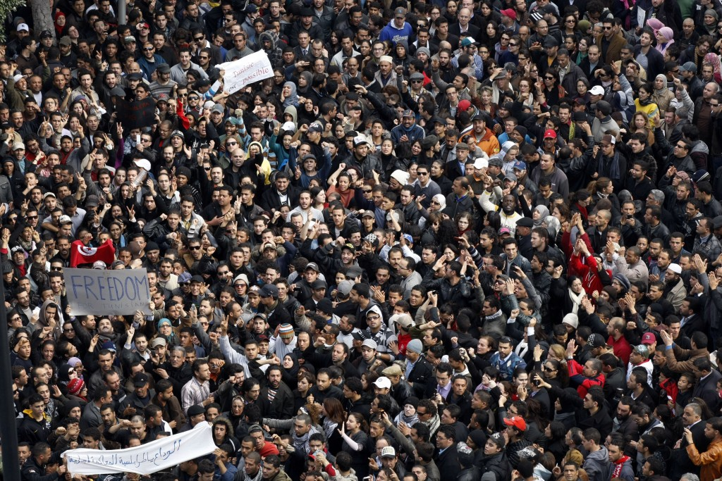 Protesters chant slogans against President Zine El Abidine Ben Ali during a demonstration in Tunis, Friday, Jan. 14, 2011. Thousands of angry demonstr...