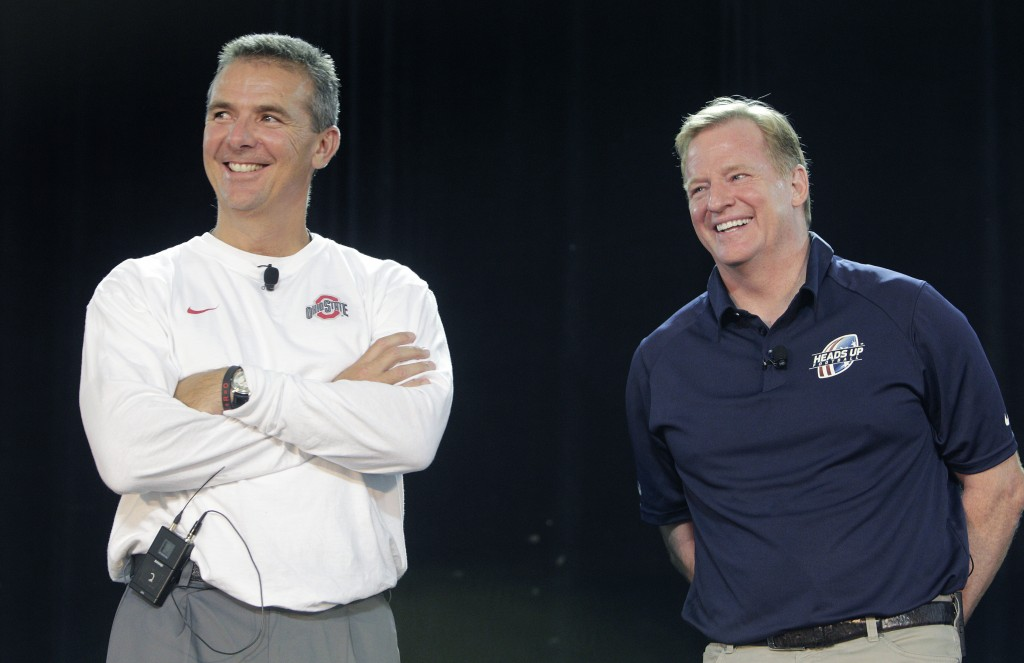 FILE - NFL Commissioner Roger Goodell, right, and Ohio State NCAA college football head coach Urban Meyer answer questions during a safety clinic for ...