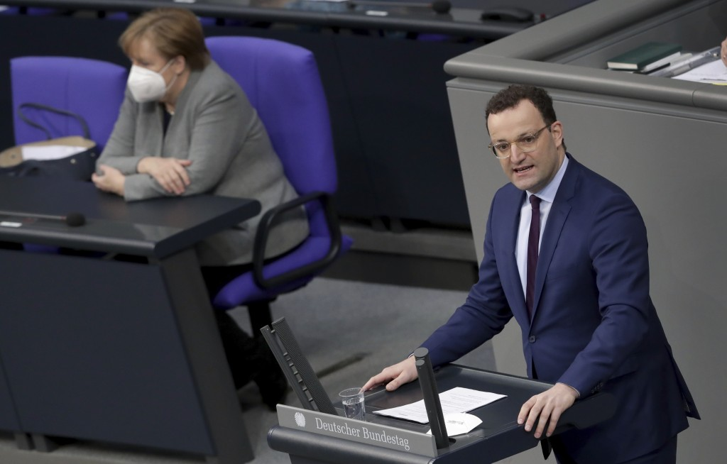 File - In this Wednesday, Jan. 13, 2021 file photo German Chancellor Angela Merkel listen to German Health Minister Jens Spahn holding a speech on the...