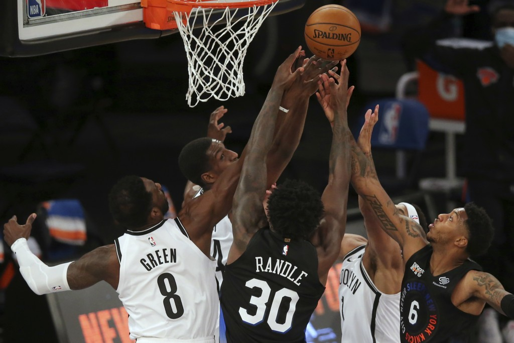 Brooklyn Nets forwards Jeff Green (8) and forward Reggie Perry (14) and guard Bruce Brown (1) fight for a rebound against New York Knicks forward Juli...