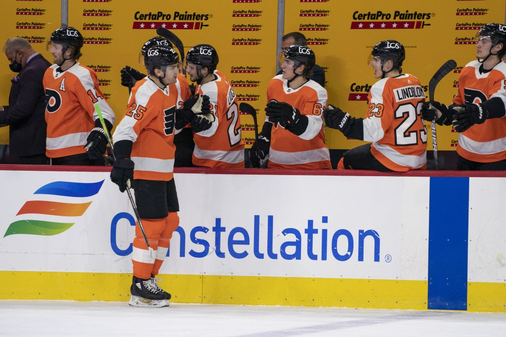 Philadelphia Flyers' James van Riemsdyk celebrates his goal with teammates during the first period of an NHL hockey game against the Pittsburgh Pengui...