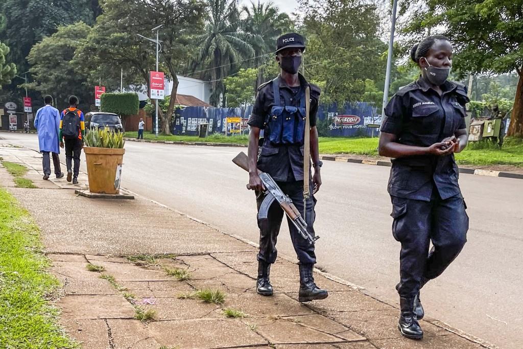 Security forces patrol in Kampala, Uganda Wednesday, Jan. 13, 2021.The United States ambassador to Uganda said Wednesday the embassy has canceled plan...