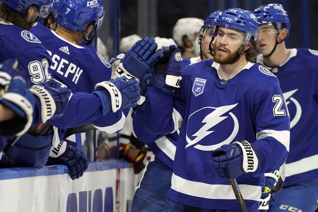 Tampa Bay Lightning center Brayden Point (21) celebrates with the bench after his goal against the Chicago Blackhawks during the third period of an NH...
