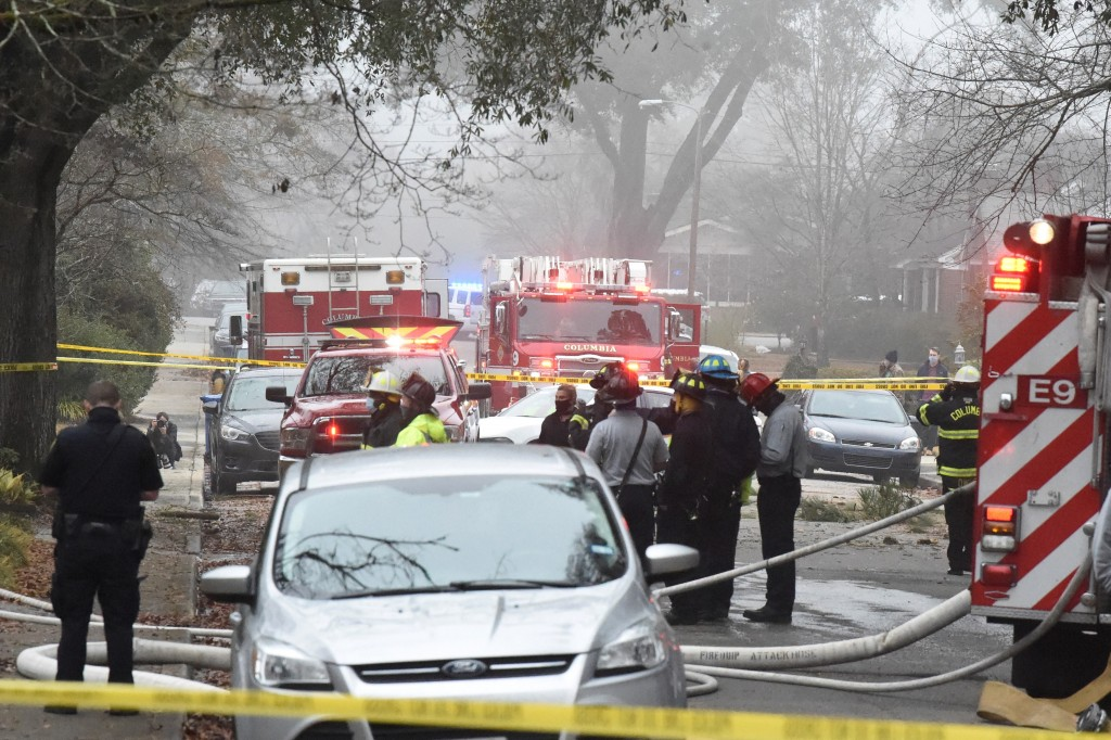 Officials clean up the scene following a small plane crash during dense fog in a residential neighborhood on Wednesday, Jan. 13, 2021, in Columbia, S....