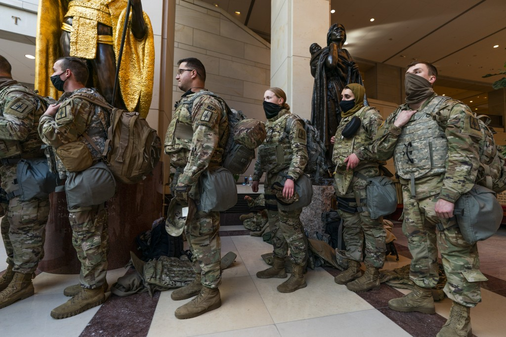 Members of the National Guard gather at inside the Capitol Visitor Center, Wednesday, Jan. 13, 2021, in Washington as the House of Representatives con...