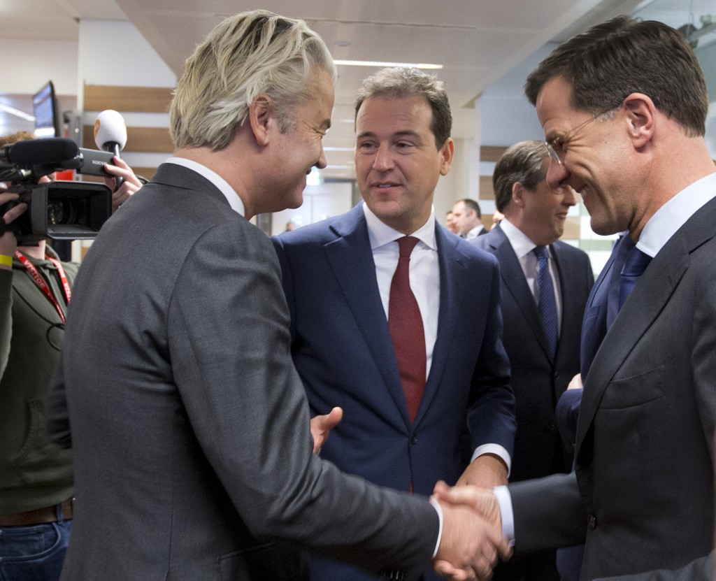 FILE- In this March 5, 2017, file photo, Labour Party leader Lodewijk Asscher, center, Dutch Prime Minister Mark Rutte, right, and firebrand anti Isla...