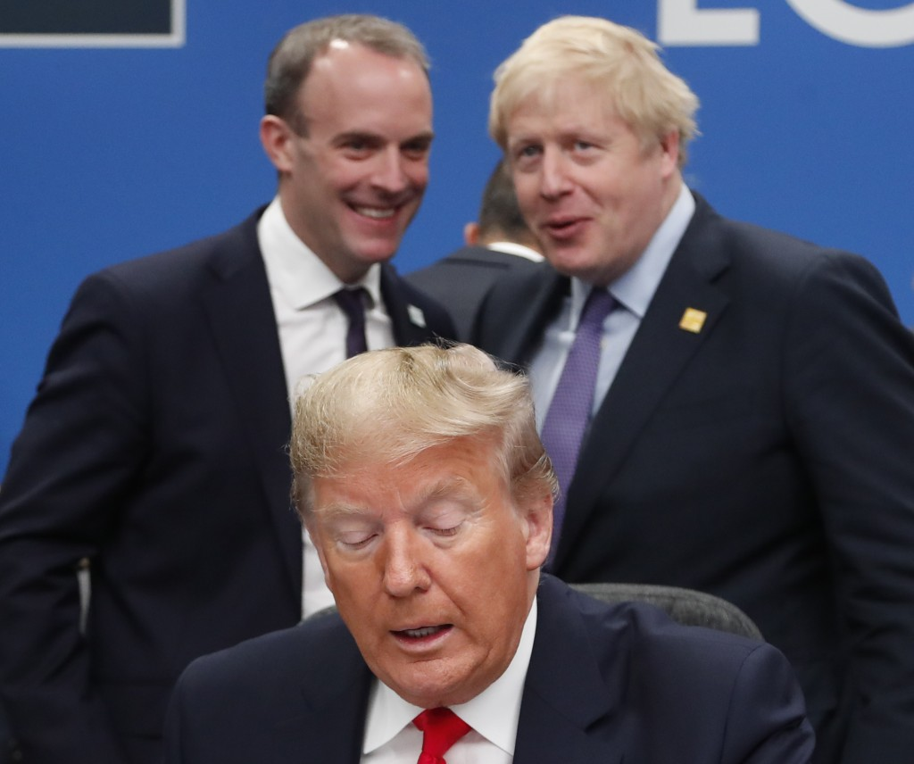 FILE - In this Wednesday, Dec. 4, 2019 file photo U.S. President Donald Trump, center, seated, British Prime Minister Boris Johnson, rear right, and B...