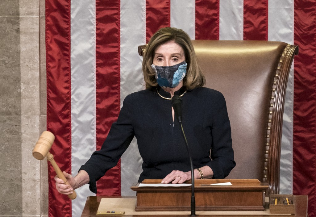 Speaker of the House Nancy Pelosi, D-Calif., leads the final vote of the impeachment of President Donald Trump for his role in inciting an angry mob t...
