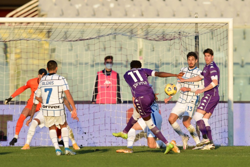 Fiorentina's Christian Kouame, center with back to camera (11) scores the equalizing goal during an Italian Cup round of 16 soccer match between Fiore...