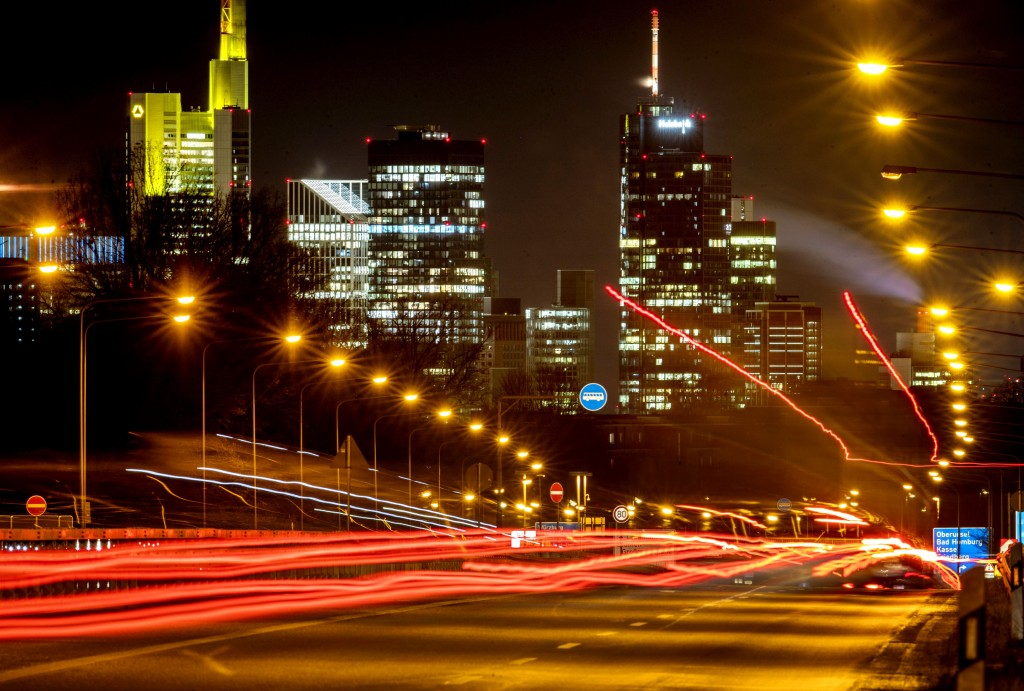 Long time exposure photo shows commuters driving towards Frankfurt, Germany, Thursday, Jan. 14, 2021. In background the buildings of the banking distr...