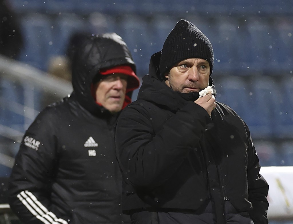 Munich's coach Hansi Flick, right, stands at the side lines during the DFB Cup 2nd round match between Holstein Kiel and Bayern Munich at the Holstein...