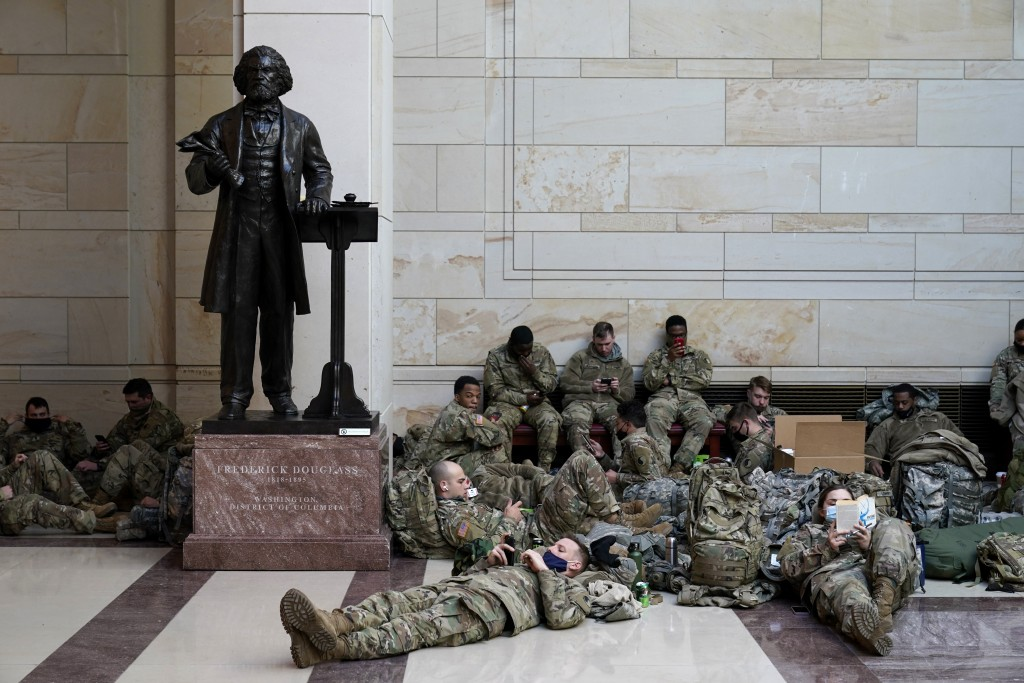 Troops hold inside the Capitol Visitor's Center to reinforce security at the Capitol in Washington, Wednesday, Jan. 13, 2021. The House of Representat...