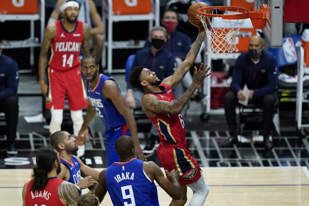 New Orleans Pelicans guard Nickeil Alexander-Walker (6) shoots past Los Angeles Clippers center Serge Ibaka (9) during the second quarter of an NBA ba...