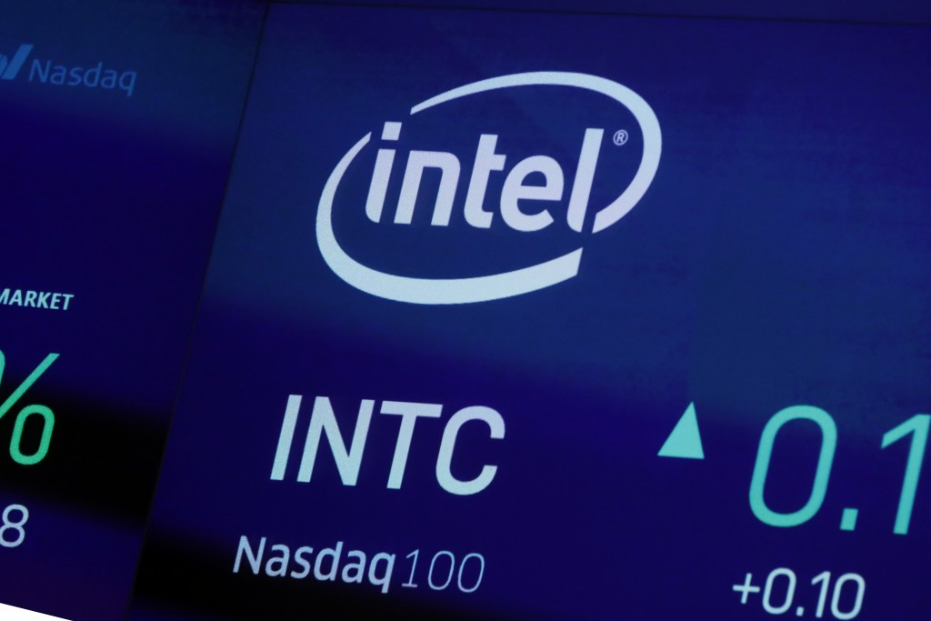 FILE - In this Oct. 1, 2019, file photo the symbol for Intel appears on a screen at the Nasdaq MarketSite, in New York.  Intel is replacing its CEO af...