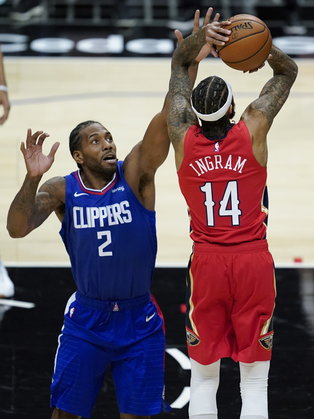 Los Angeles Clippers forward Kawhi Leonard (2) defends against New Orleans Pelicans forward Brandon Ingram (14) during the first quarter of an NBA bas...