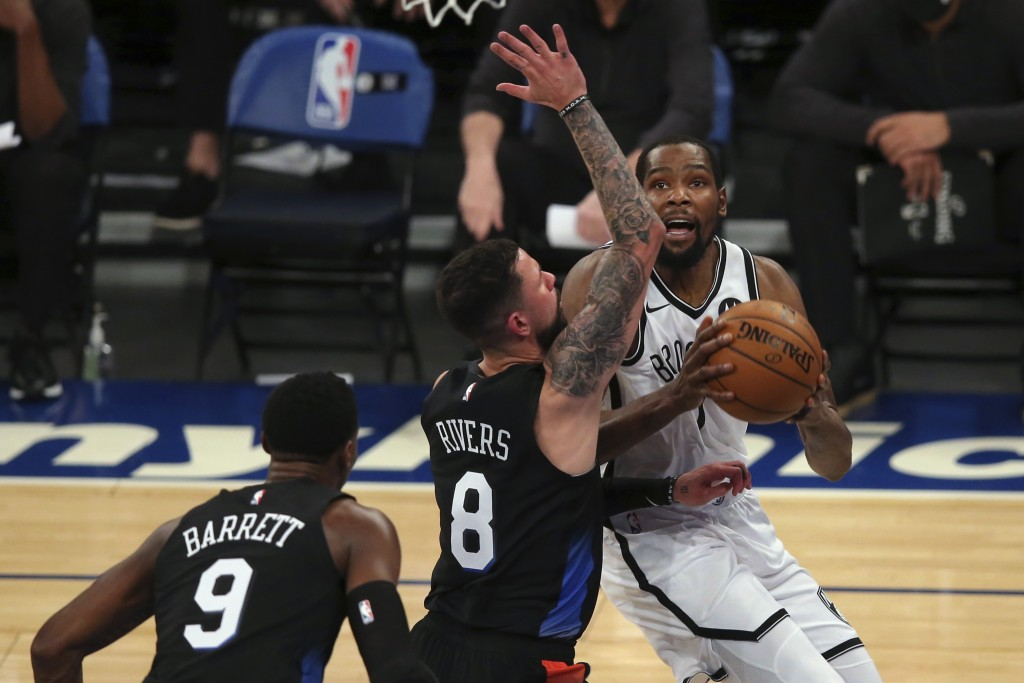 Brooklyn Nets forward Kevin Durant (7) drives to the basket against New York Knicks guards Austin Rivers (8) and RJ Barrett (9) during the first quart...