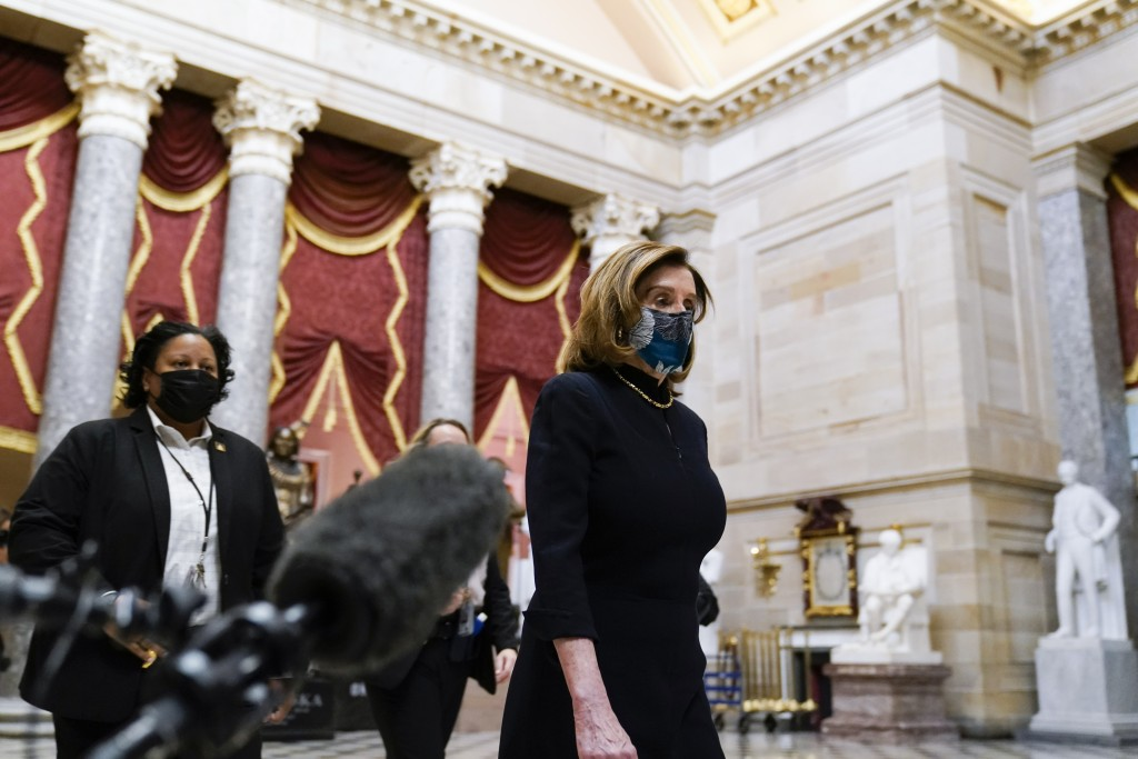 Speaker of the House Nancy Pelosi of Calif., returns to her leadership office from the House chamber at the Capitol in Washington, Wednesday, Jan. 13,...