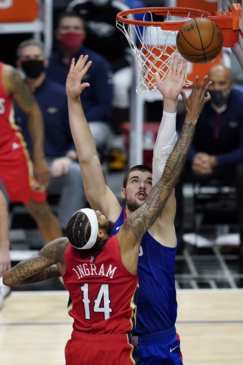 Los Angeles Clippers center Ivica Zubac, rear, defends against New Orleans Pelicans forward Brandon Ingram (14) during the second quarter of an NBA ba...