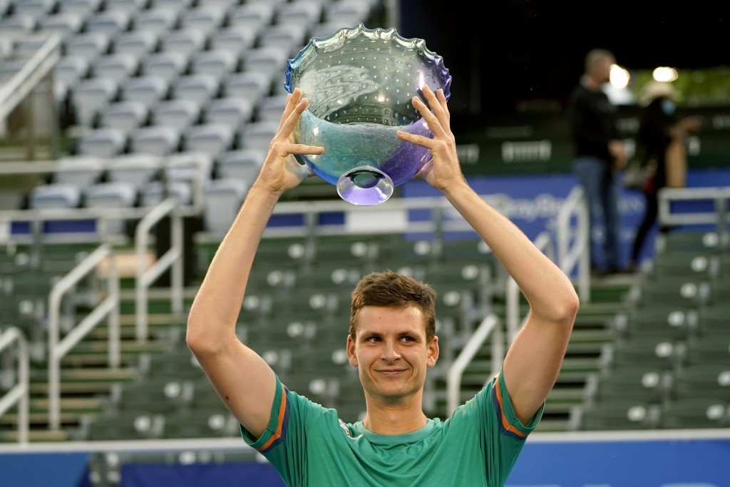 Hubert Hurkacz of Poland, holds the trophy after defeating Sebastian Korda 6-3, 6-3 during the men's singles final of the Delray Beach Open tennis tou...