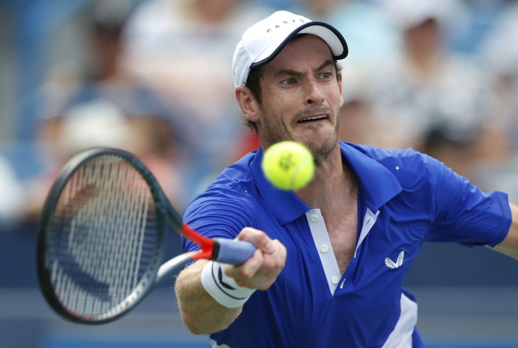 FILE - In this Monday, Aug. 12, 2019 file photo Andy Murray, of Britain, hits a forehand against Richard Gasquet, of France, during first-round play a...