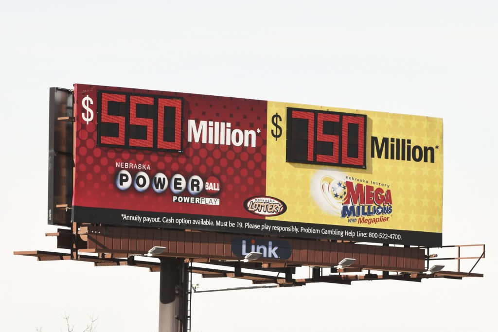 A billboard advertises the jackpots of the Powerball and Mega Millions lotteries, in Omaha, Neb., Wednesday, Jan. 13, 2021. Lottery players will have ...