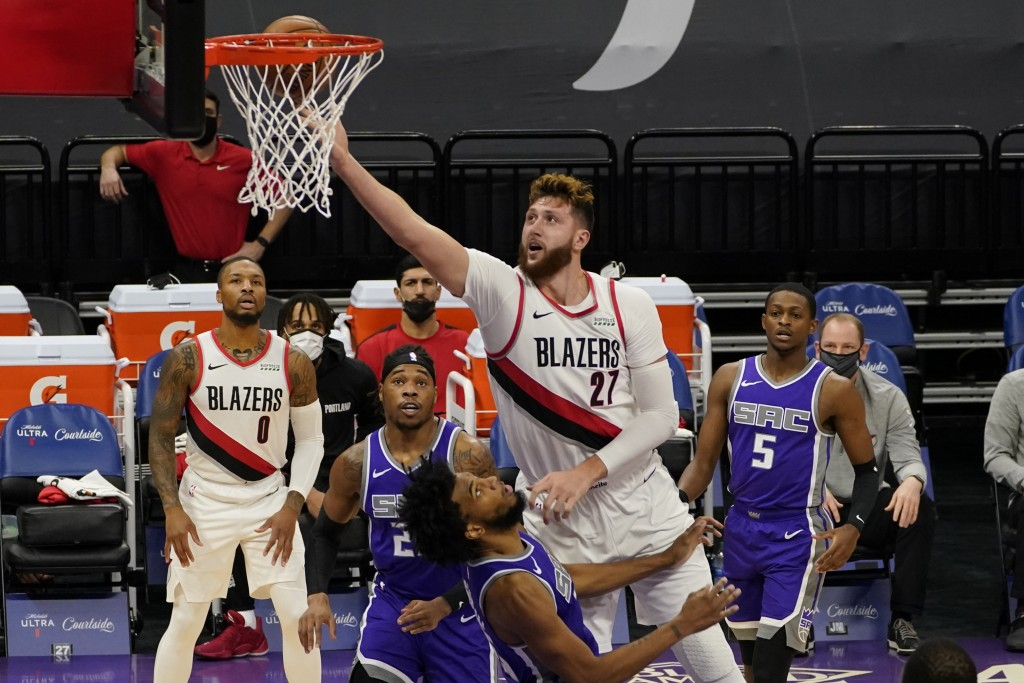 Portland Trail Blazers center Jusuf Nurkic, right, goes to the basket over Sacramento Kings forward Marvin Bagley III, foreground center, during the f...