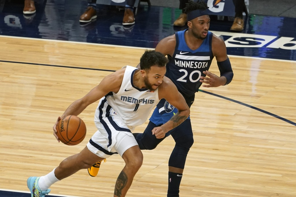 Memphis Grizzlies' Kyle Anderson (1) races to the basket with Minnesota Timberwolves' Josh Okogie (20) in pursuit in the first half of an NBA basketba...
