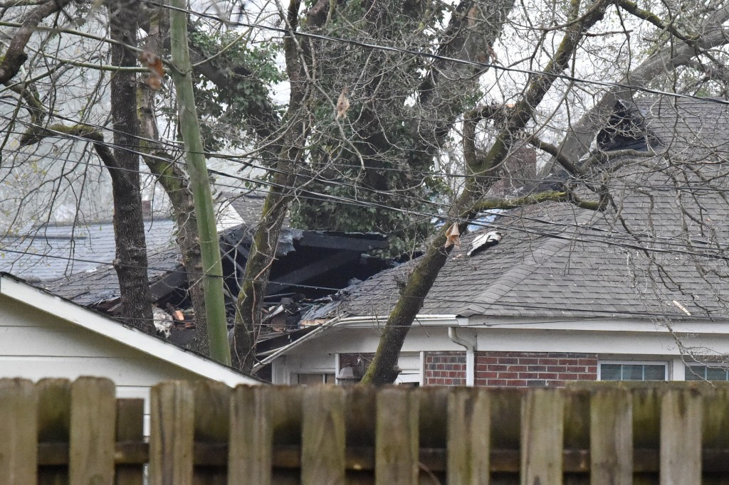 Damage is visible following a small plane crash during dense fog in a residential neighborhood on Wednesday, Jan. 13, 2021, in Columbia, S.C. Official...