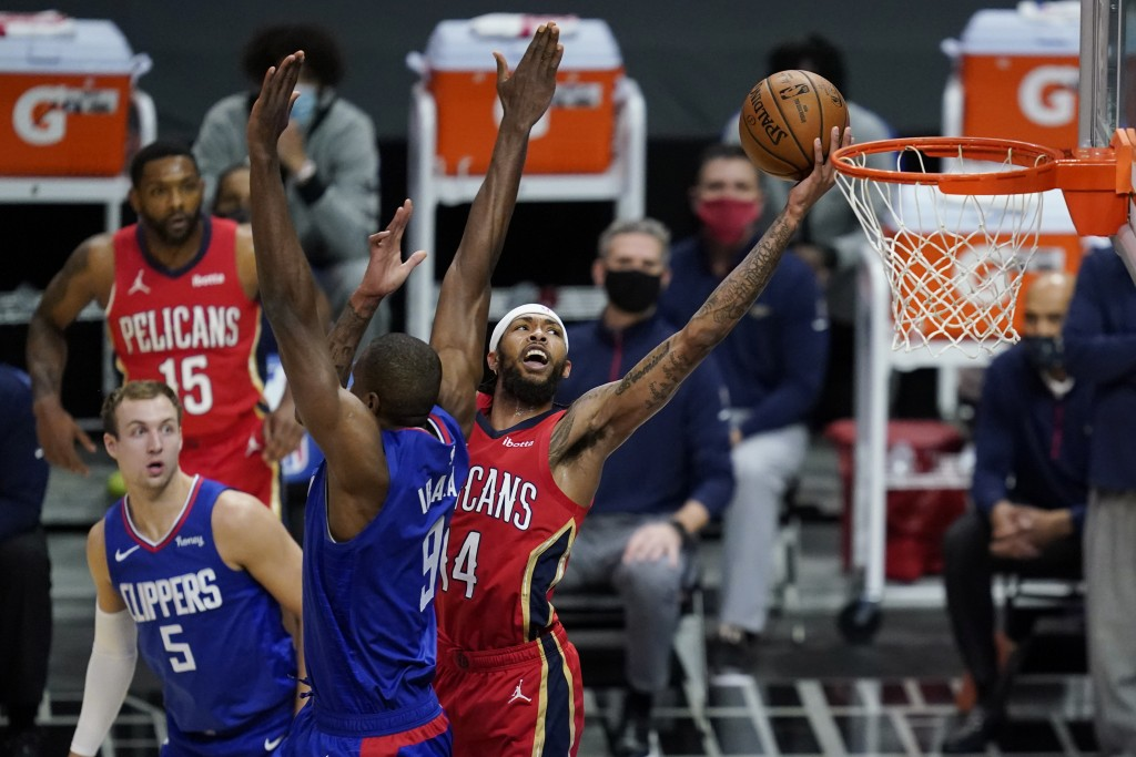 New Orleans Pelicans forward Brandon Ingram (14) shoots next to Los Angeles Clippers center Serge Ibaka (9) during the first quarter of an NBA basketb...