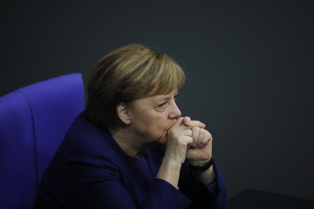 File - In this Tuesday, Dec. 8, 2020 file photo, German Chancellor Angela Merkel attends the debate about Germany's budget 2021, at the parliament Bun...