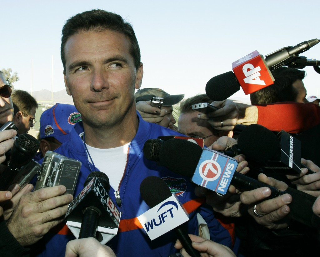 FILE - Florida NCAA college football head coach Urban Meyer talks to reporters after practice in Scottsdale, Ariz., ahead of the BCS Championship game...
