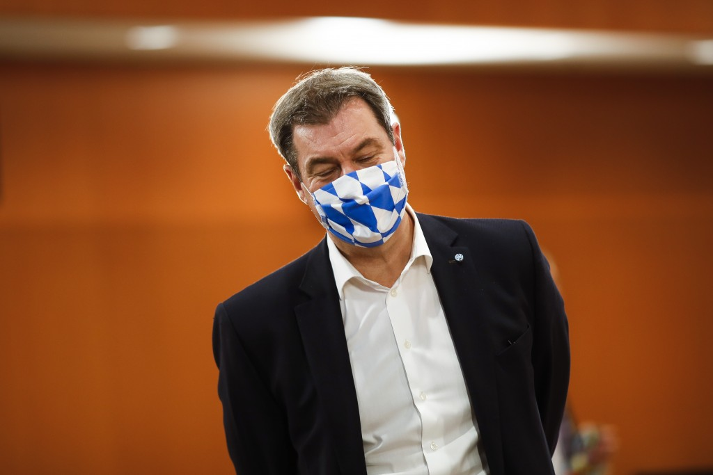 File - In this Wednesday, June 17, 2020 file photo Bavarian Prime Minister Markus Soeder of the Christian Social Union, CSU, party, wears a face mask ...