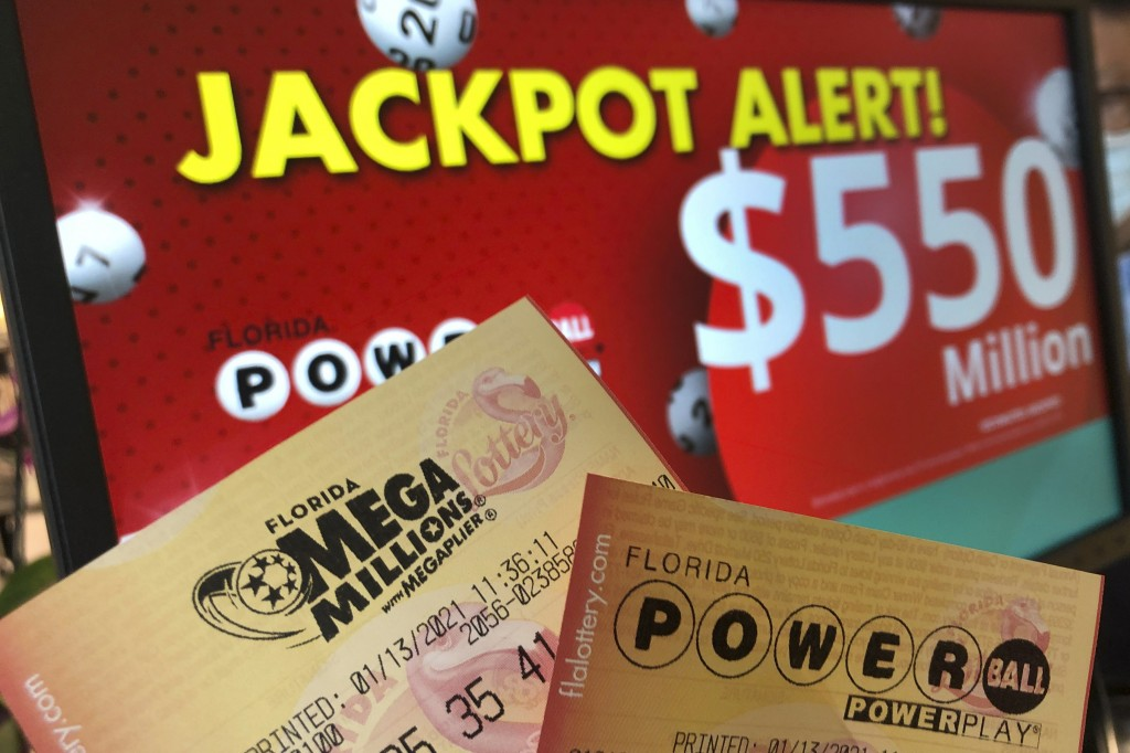 Powerball and Mega Millions lottery tickets are shown at a retailer, Wednesday, Jan. 13, 2021, in Surfside, Fla. Lottery players will have a shot Frid...