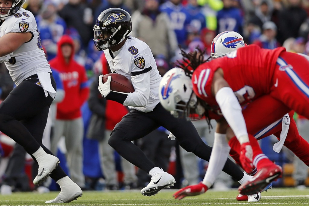 FILE - Baltimore Ravens quarterback Lamar Jackson (8) carries the ball during the first half of an NFL football game against the Buffalo Bills in Orch...