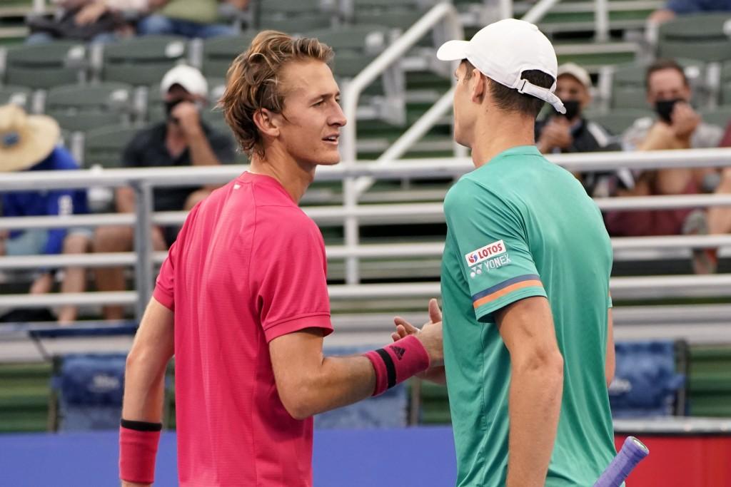 Hubert Hurkacz of Poland, right, shakes hands with Sebastian Korda, left, during the men's singles final of the Delray Beach Open tennis tournament, W...