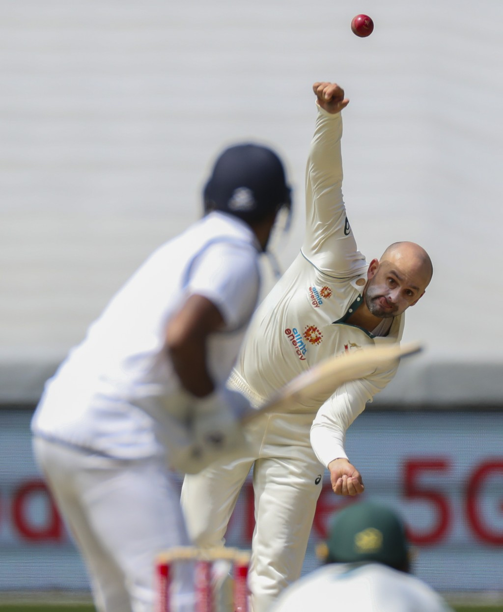 Australia's Nathan Lyon bowls during play on day three of the second cricket test between India and Australia at the Melbourne Cricket Ground, Melbour...