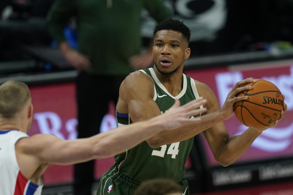 Milwaukee Bucks forward Giannis Antetokounmpo (34) looks to pass during the first half of an NBA basketball game against the Detroit Pistons, Wednesda...