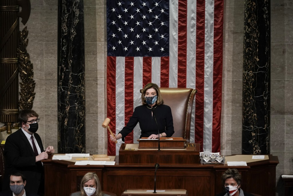 Speaker of the House Nancy Pelosi, D-Calif., leads the final vote of the impeachment of President Donald Trump, for his role in inciting an angry mob ...
